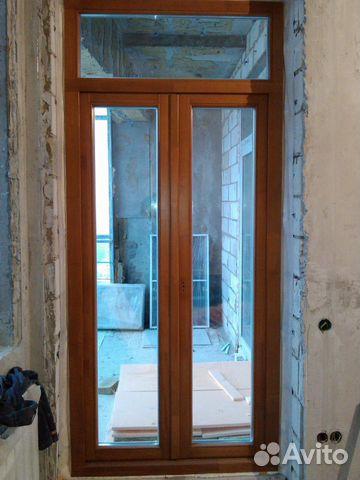 Новая двустворчатая балконная дверь из лиственницы - строите.